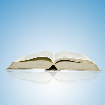 bibliomania: Open book on blue background