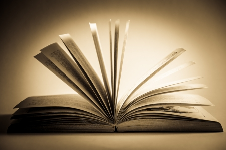 Old Fashioned Open Book Lighted Vintage Background  Stock Photo