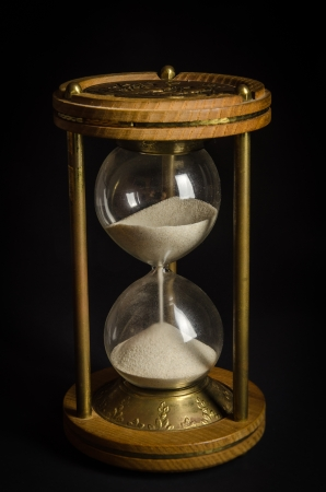 Old hourglass on black background Stock Photo - 17921263