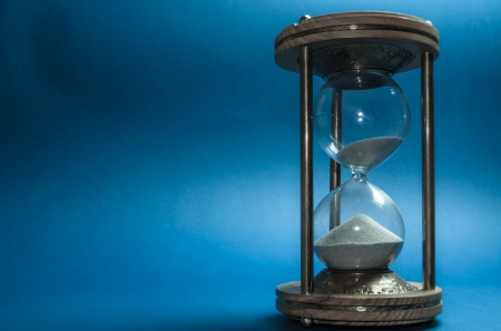 hourglass on blue background  Stock Photo