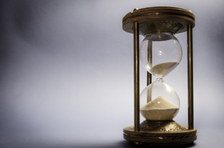 sands of time: Old hourglass on grey background