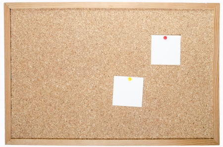 white pages pinned to cork board  photo