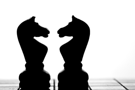 Chess pieces in conflict  photo