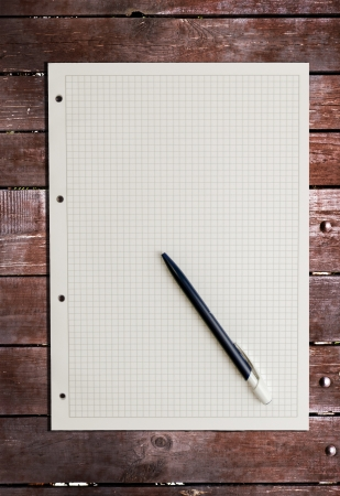sheet of paper on wood background Stock Photo - 17911714