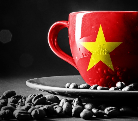 Vietnam flag on cup of coffee  photo