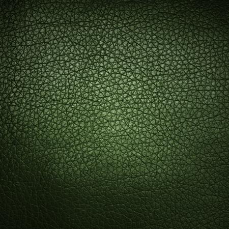 Groene lederen textuur close-up als achtergrond Stockfoto