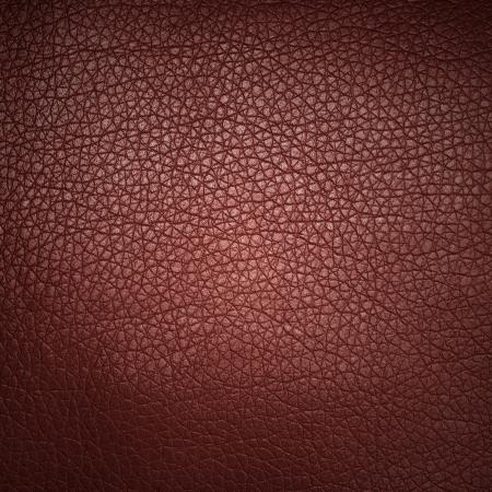 赤い革のテクスチャのクローズ アップ、背景として役に立つ