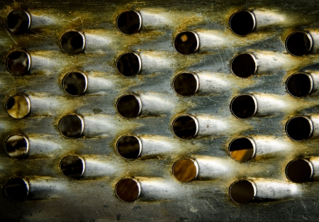 Grill metal hole on grunge texture background  photo