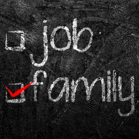 job and family of your choice written with white chalk on black background  photo