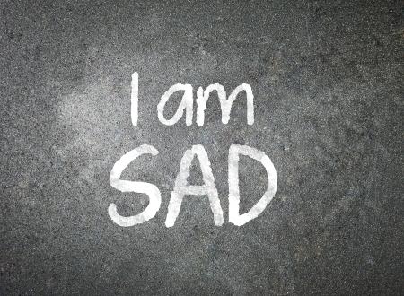 i am: I am Sad handwritten with white chalk on a blackboard   Stock Photo