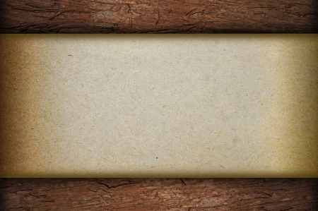 Paper on wood background  Stock Photo - 18606439