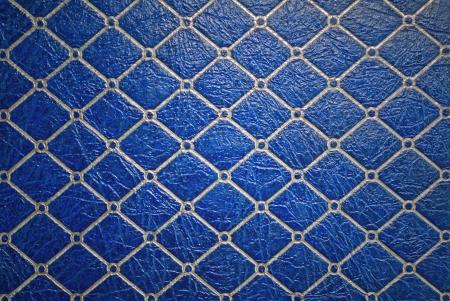 Dark blue decorative leather background or texture
