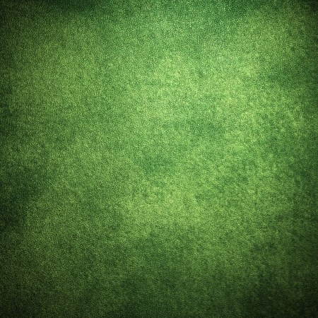 bright center:  abstract green background or Christmas background with bright center spotlight and black vignette border frame with vintage grunge background texture  Stock Photo