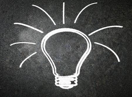 scriibble: Light bulb on blackboard background