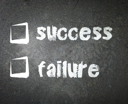 Success and failure handwritten with white chalk on a blackboard with check box  photo