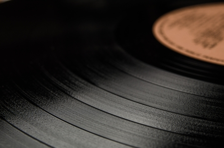 Segment of vinyl record with label showing the texture of the grooves , retro look