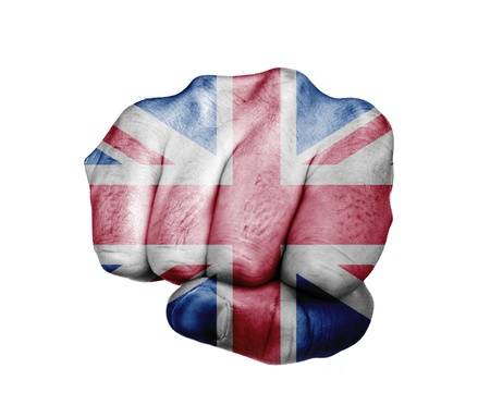 Low key picture of a fist painted in colors of united kingdom flag