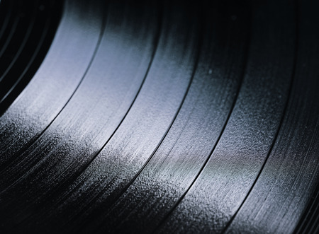 grooves: Segment of vinyl record with label showing the texture of the grooves, retro look
