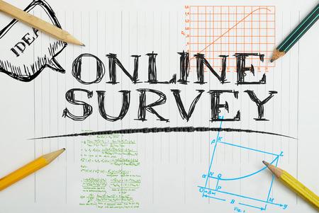 online survey: paper notebook with inscription online survey, business concept