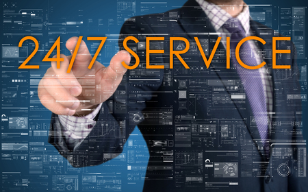 24x7: The businessman is choosing from 247 service touch screen