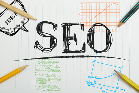 concerning: note in the notebook Concerning SEO with pencils around Stock Photo