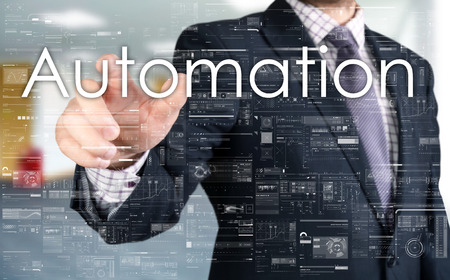 size distribution: The businessman is choosing from touch screen Automation Stock Photo