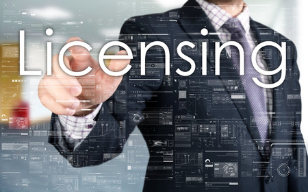 licensing: The businessman is choosing from touch screen Licensing Stock Photo