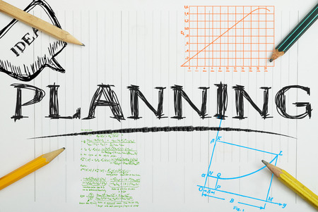 planificacion: cuaderno de papel con la planificación de la inscripción, concepto de negocio Foto de archivo