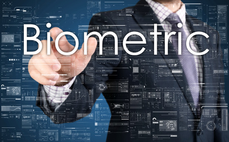 biometric: The businessman is choosing Biometric from touch screen Stock Photo