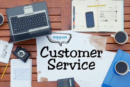customer facing: paper notebook with inscription Customer Service