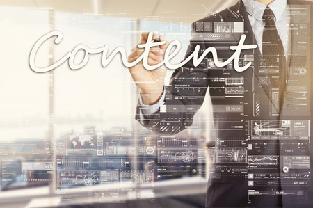 the businessman in the office is writing on the transparent board: Content Stock Photo