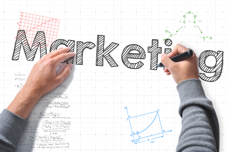 adwords: hands with marker writing marketing