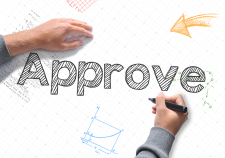 Approve Hand writing on a white sheet of paper Stock Photo