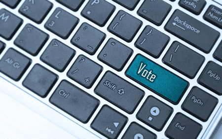 vote or voting concepts, through computer or the Internet, with a message on enter key of keyboard.