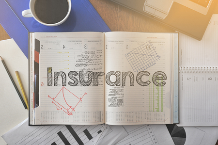 homeowners: Insurance - text inside notebook on table with coffee Stock Photo