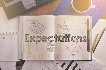 Notebook with text inside: Expectations Stock Photo