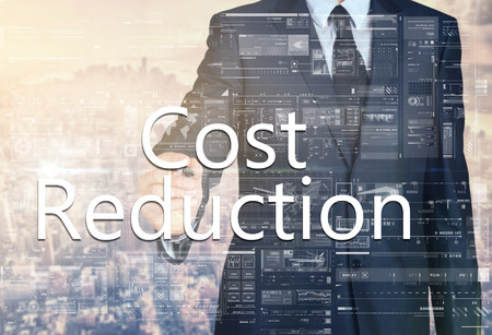 cost reduction: Cost Reduction Businessman writing on a virtual screen