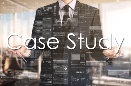 Businessman presenting text Case Study team on virtual screen. He is in the office Stock Photo