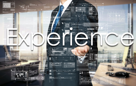 hiring practices: Businessman presenting text Experience on virtual screen. He is in the office