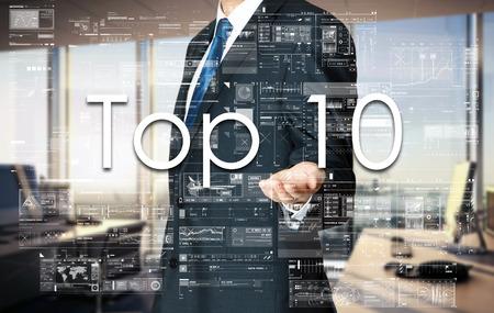 Businessman presenting text Top 10 on virtual screen.