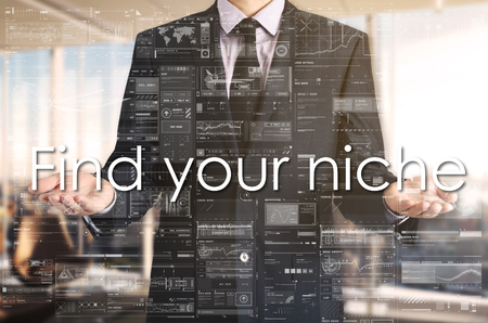 niche: Businessman presenting text Find Your Niche on virtual screen.