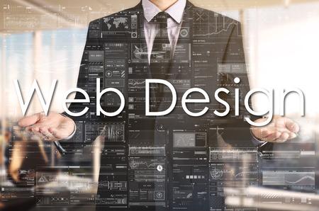 Businessman presenting text Web Design on virtual screen. Stock Photo