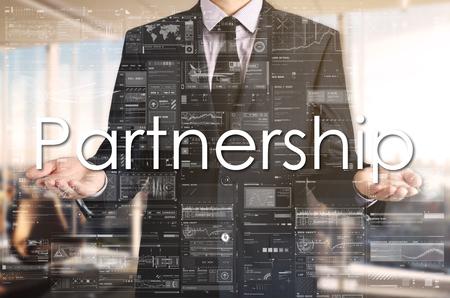harmonize: Businessman presenting text Partnership on virtual screen.