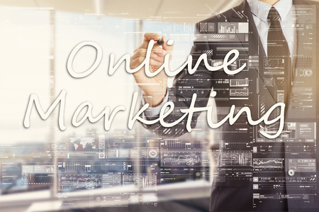 factor: the businessman in the office is writing on the transparent board: Online Marketing
