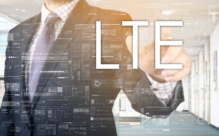conection: the businessman is choosing LTE from touch screen