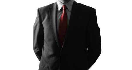 Anonymous businessman standing in white background