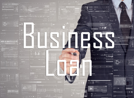 rating: businessman writing Business Loan and drawing graphs and diagrams on grey background Stock Photo