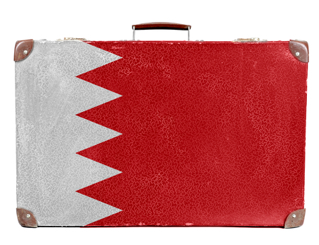 Vintage travel bag with flag of Bahrain Stock Photo