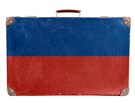 Vintage travel bag with flag of Haiti Stock Photo