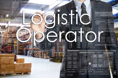 the businessman is writing things connected with the logistics in warehouse. Logistic Operator
